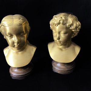 Paire de bustes d'enfants en bronze doré XIXe